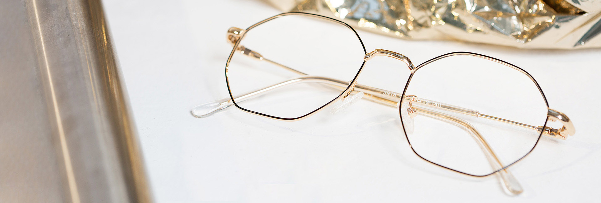 lenses and gold metal glasses